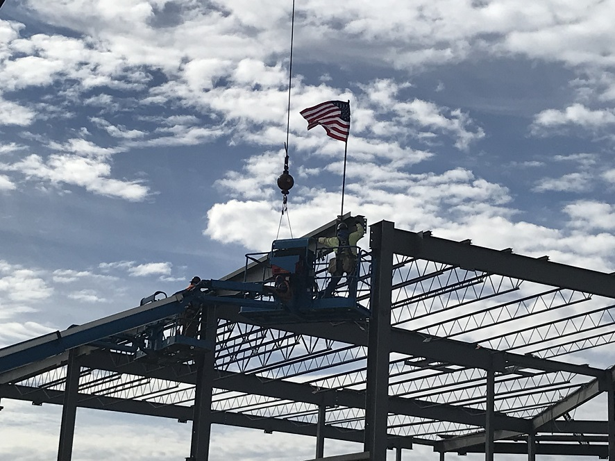 Man Putting American Flag on Beam